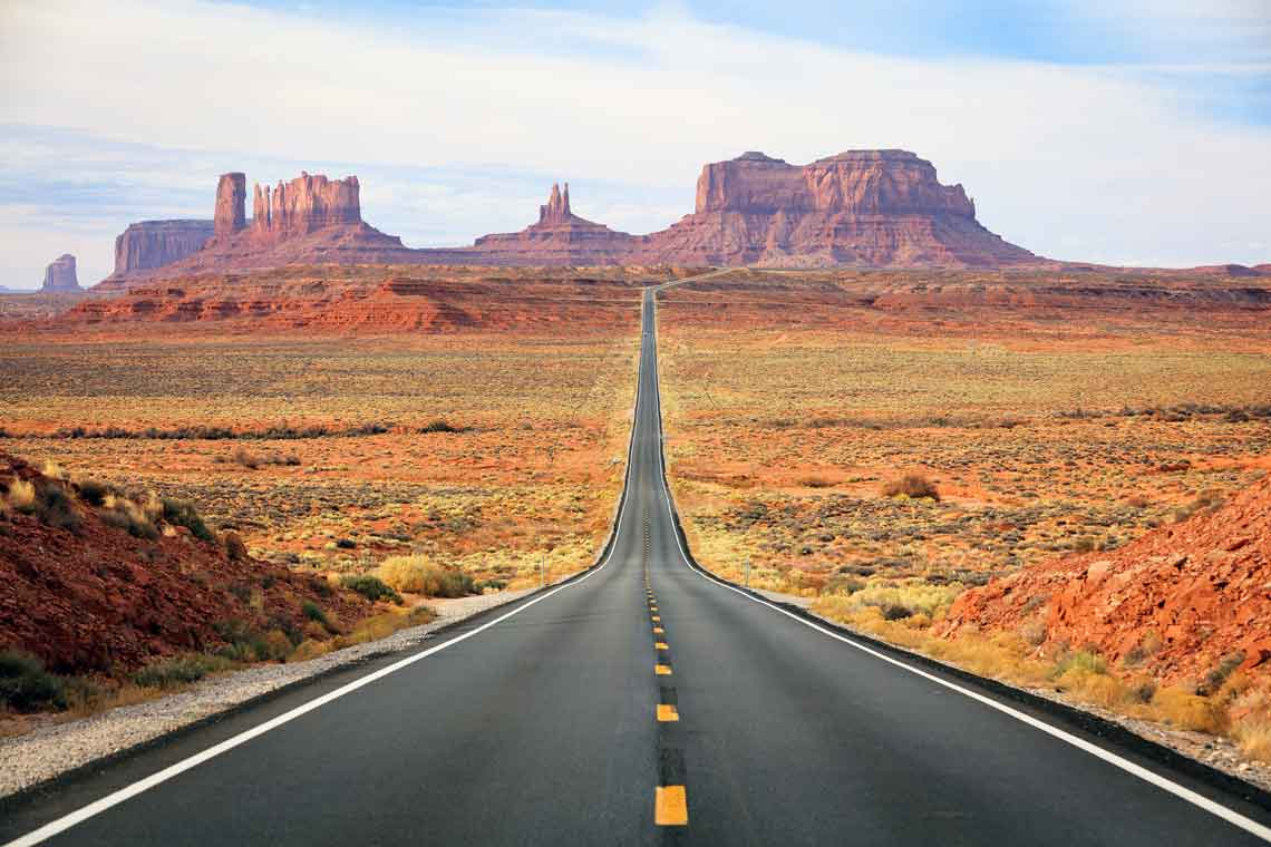 A long highway road leading through Nevada